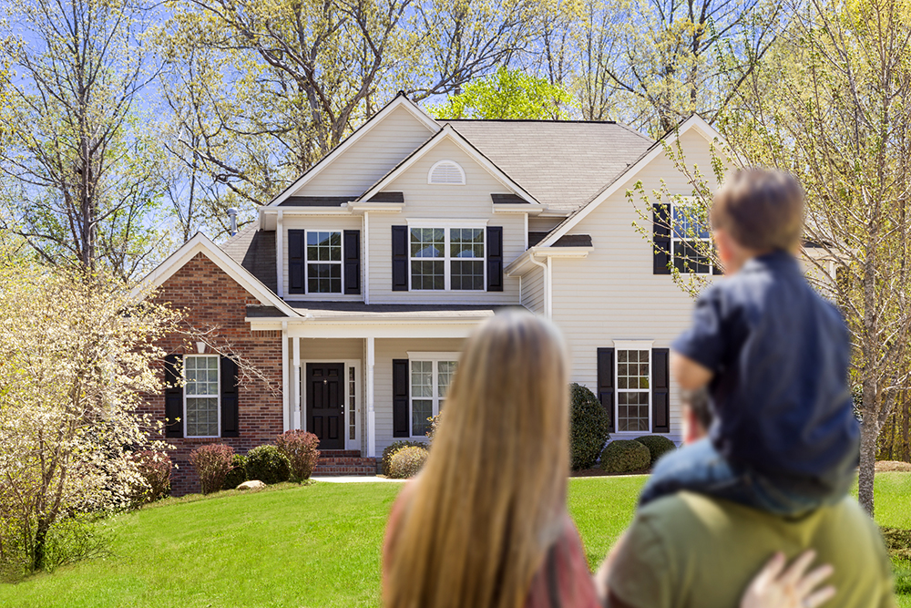 family of three looking at their new house after a home inspection